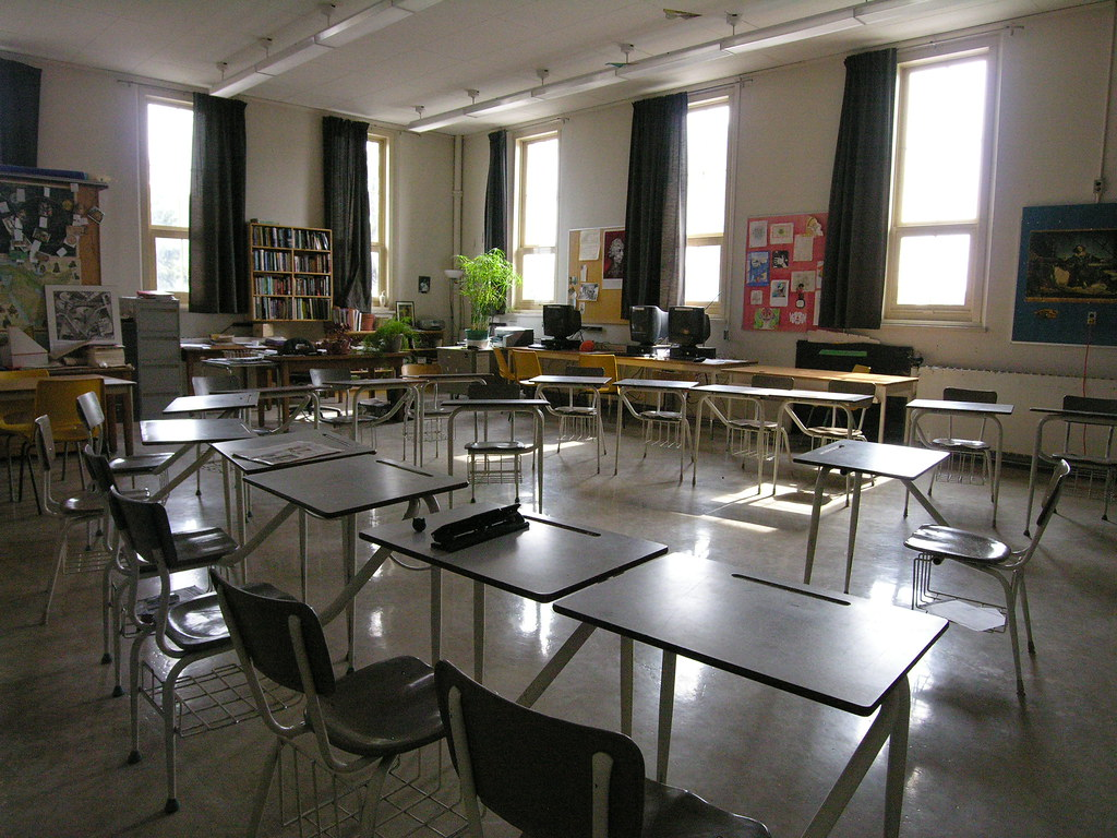 "Classroom. Attribution: <p style=""font-size: 0.9rem;font-style: italic;""><a href=""https://www.flickr.com/photos/52678969@N05/5604587723"">""classroom 2nd fl""</a><span>by <a href=""https://www.flickr.com/photos/52678969@N05"">cayoup</a></span> is licensed under <a href=""https://creativecommons.org/licenses/by-nc-sa/2.0/?ref=ccsearch&atype=html"" style=""margin-right: 5px;"">CC BY-NC-SA 2.0</a><a href=""https://creativecommons.org/licenses/by-nc-sa/2.0/?ref=ccsearch&atype=html"" target=""_blank"" rel=""noopener noreferrer"" style=""display: inline-block;white-space: none;opacity: .7;margin-top: 2px;margin-left: 3px;height: 22px !important;""><img style=""height: inherit;margin-right: 3px;display: inline-block;"" src=""https://search.creativecommons.org/static/img/cc_icon.svg"" /><img style=""height: inherit;margin-right: 3px;display: inline-block;"" src=""https://search.creativecommons.org/static/img/cc-by_icon.svg"" /><img style=""height: inherit;margin-right: 3px;display: inline-block;"" src=""https://search.creativecommons.org/static/img/cc-nc_icon.svg"" /><img style=""height: inherit;margin-right: 3px;display: inline-block;"" src=""https://search.creativecommons.org/static/img/cc-sa_icon.svg"" /></a></p>"