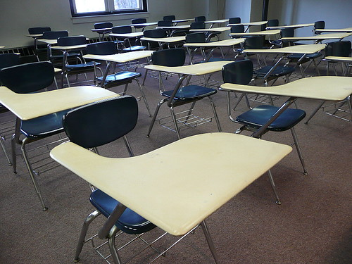 "Classroom. Attribution: <p style=""font-size: 0.9rem;font-style: italic;""><a href=""http://www.flickr.com/photos/90718153@N00/4189931447"">""Lined up in rows""</a><span>by <a href=""http://www.flickr.com/photos/90718153@N00"">Lorianne DiSabato</a></span> is licensed under <a href=""https://creativecommons.org/licenses/by-nc-nd/2.0/?ref=ccsearch&atype=html"" style=""margin-right: 5px;"">CC BY-NC-ND 2.0</a><a href=""https://creativecommons.org/licenses/by-nc-nd/2.0/?ref=ccsearch&atype=html"" target=""_blank"" rel=""noopener noreferrer"" style=""display: inline-block;white-space: none;opacity: .7;margin-top: 2px;margin-left: 3px;height: 22px !important;""><img style=""height: inherit;margin-right: 3px;display: inline-block;"" src=""https://search.creativecommons.org/static/img/cc_icon.svg"" /><img style=""height: inherit;margin-right: 3px;display: inline-block;"" src=""https://search.creativecommons.org/static/img/cc-by_icon.svg"" /><img style=""height: inherit;margin-right: 3px;display: inline-block;"" src=""https://search.creativecommons.org/static/img/cc-nc_icon.svg"" /><img style=""height: inherit;margin-right: 3px;display: inline-block;"" src=""https://search.creativecommons.org/static/img/cc-nd_icon.svg"" /></a></p>"