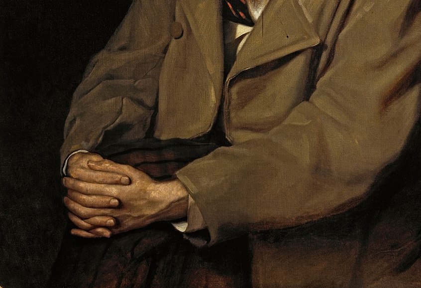 Russian writer, hands folded.